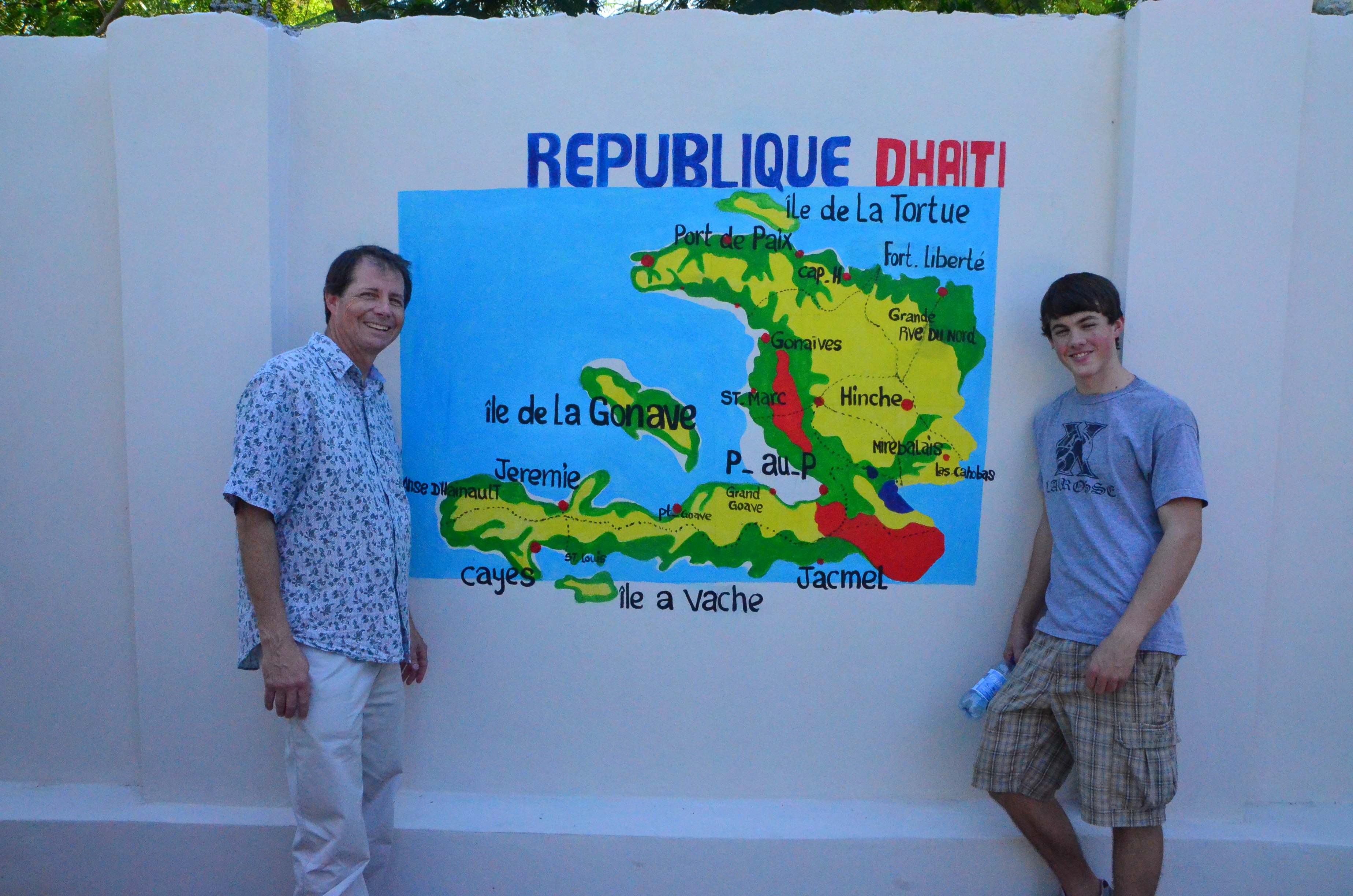 Tom and Andrew Sherer with a map of Haiti