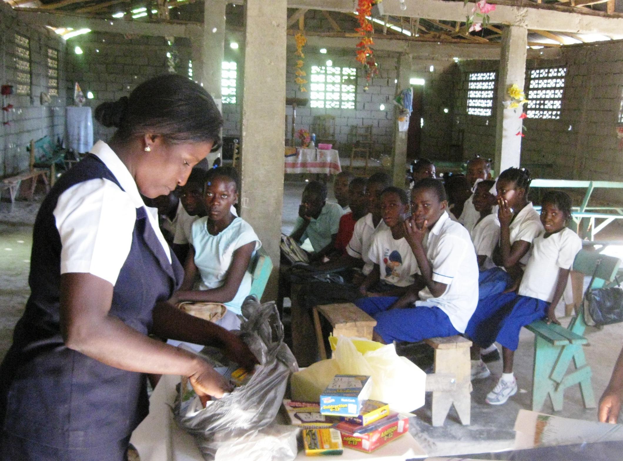 Kettelie handing out school supplies